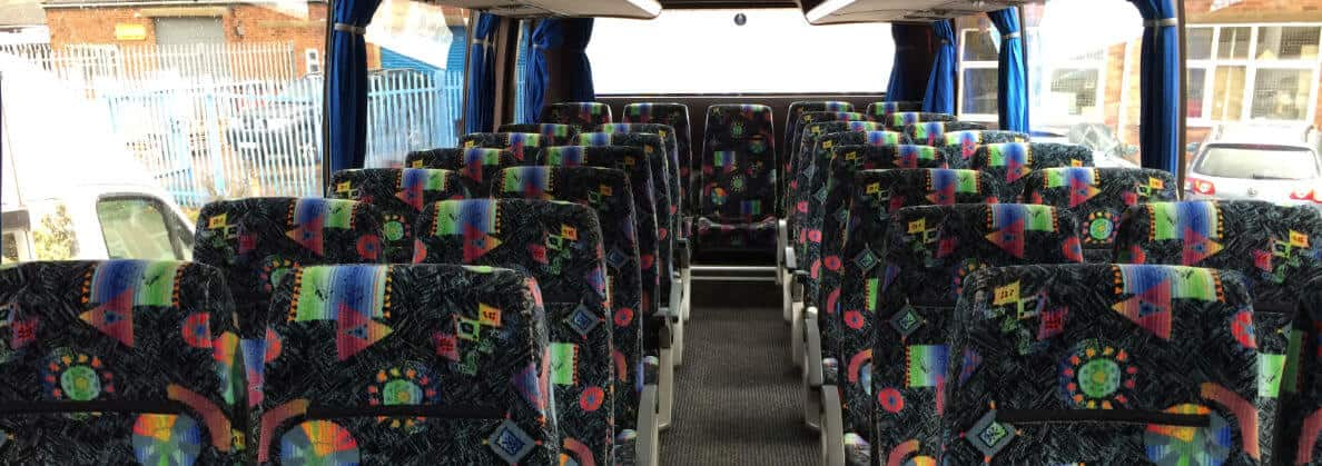 Seat belt compliant coaches