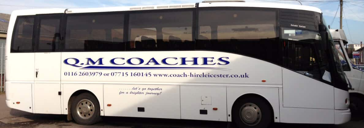 Coach parked outside school